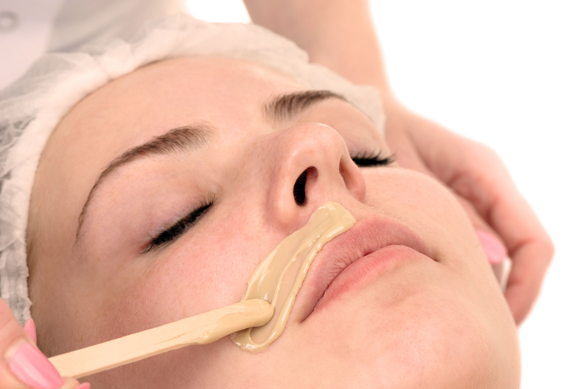 women waxing face